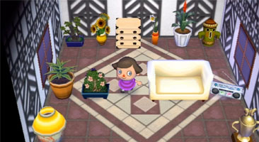 The inside of my house - decorated as a plaza, with plants and decorations.