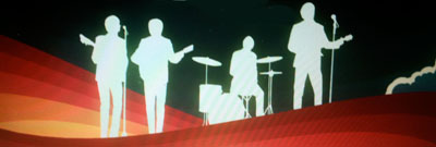 The fab four in white silhouettes on the Beatles Rock Band title screen.