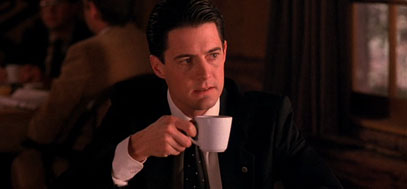 Cooper sips coffee in the hotel.