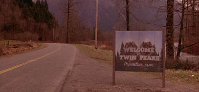 A famous shot of the Twin Peaks town sign.