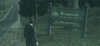 York stands in front of an open stretch of road with the Greenvale town sign on his right.