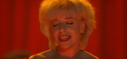 Julee Cruise sings a song in the Roadhouse.