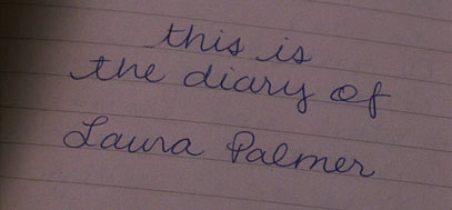A screenshot of lined paper with the words This is the diary of Laura Palmer written in blue ink.