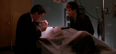 Cooper and the Sheriff at in the hospital morgue, examining Laura Palmer's body.