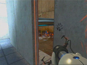 A black handprint leads Chell behind the scenes.