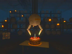 GLaDOS's arm extends to put the candle out on the cake.