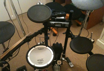 My Roland TD-4 which I am using to play Rock Band 3 with, the MIDI pro rests on top of the drum brain.