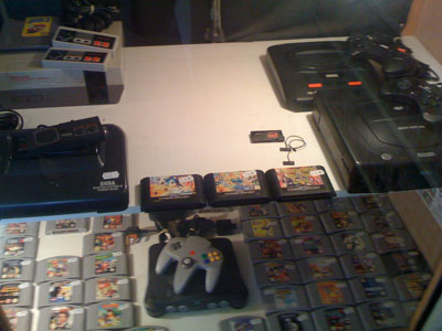 Retro consoles with N64 in forefront.