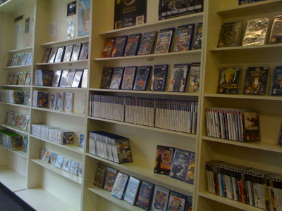 Current gen games stacked neatly on shelves.