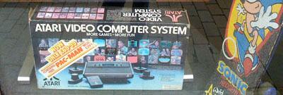 An Atari box and Sonic Skateboard in the R Games shop window.