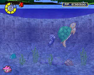 Tombi swims with the pond's turtle.