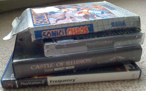 A stack of games including; Sonic Chaos, Castle of Illusion, Kurushi and Frequency.